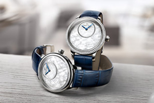 A NEW GOLD AND MOTHER-OF-PEARL FACE FOR THE PETITE HEURE MINUTE